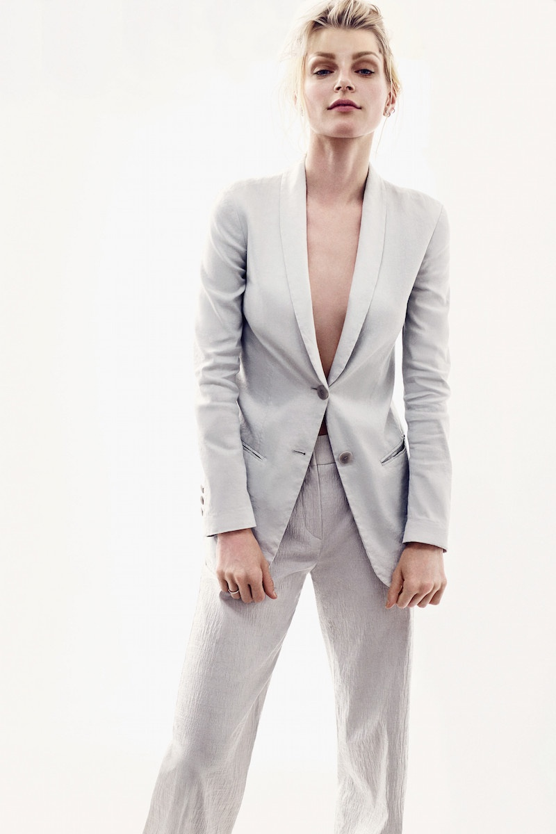 The Canadian model keeps it minimal in a grey pant suit