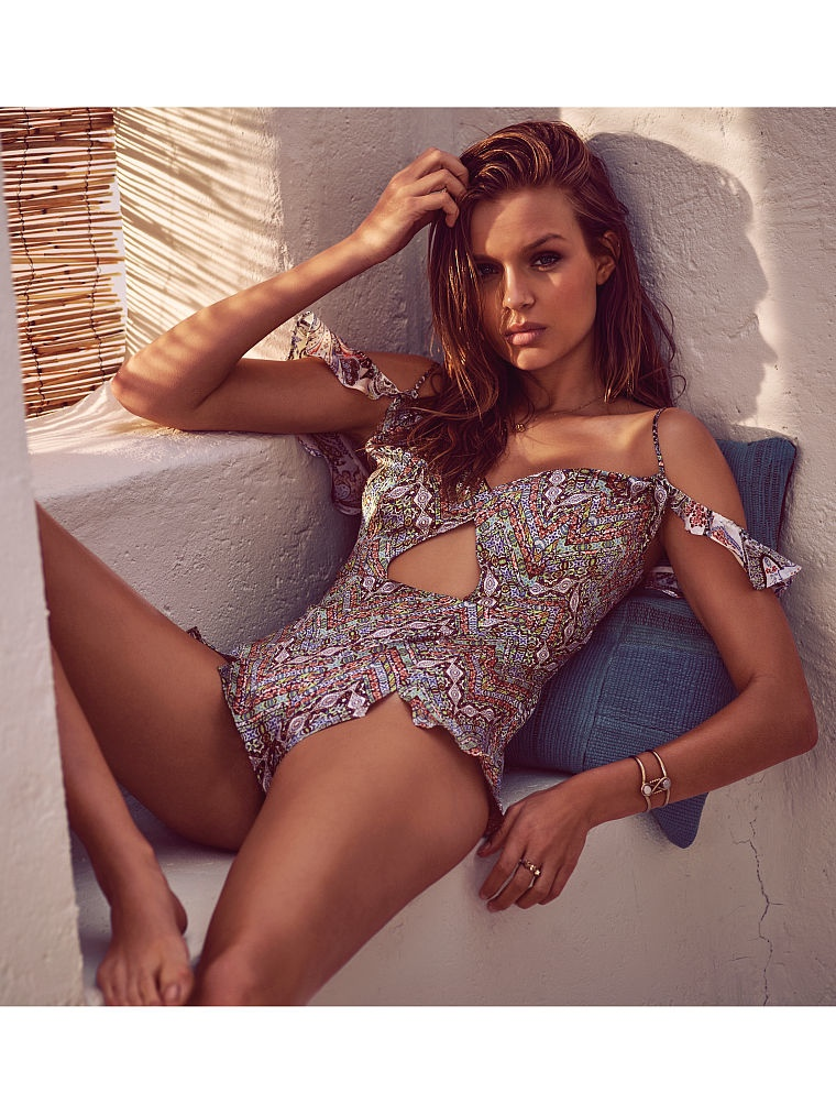 Josephine sports a one-piece swimsuit with a cut-out detail