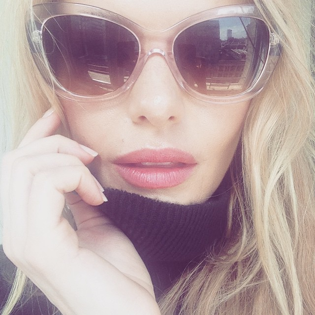 Kate Bosworth wears Coach sunglasses with a trendy cat eye shape