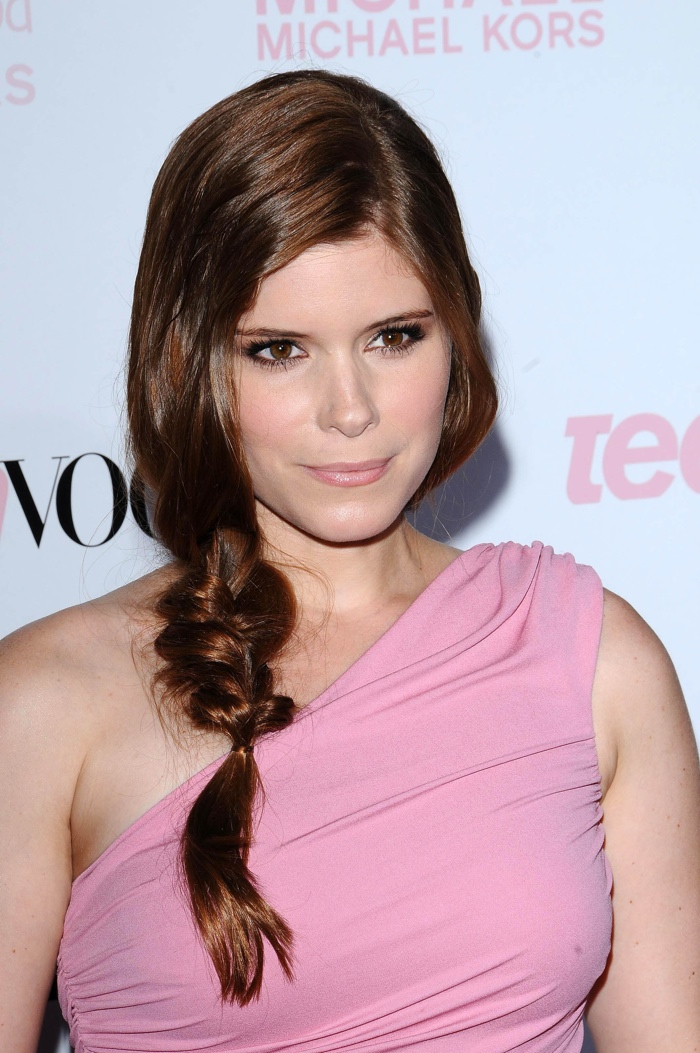 Kate Mara shows off her natural auburn hair with a braided ponytail styled to the side.