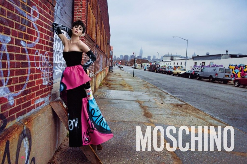 Katy wears a graffiti covered dress from Moschino