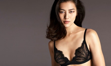 Liu Wen models a sensuous lingerie look for La Perla's fall-winter 2015 advertising captured by Mert & Marcus.