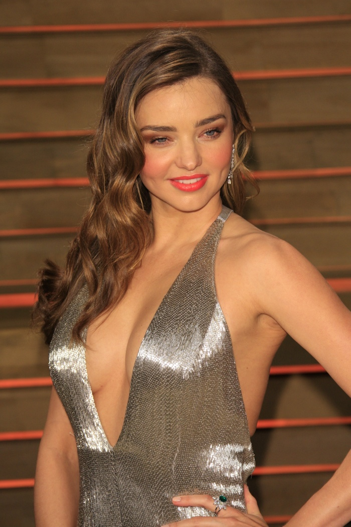 The former Victoria's Secret model looked like a retro bombshell at the 2014 Vanity Fair Oscar Party with subtle waves in her balayage highlighted hair. Photo: Helga Esteb / Shutterstock.com