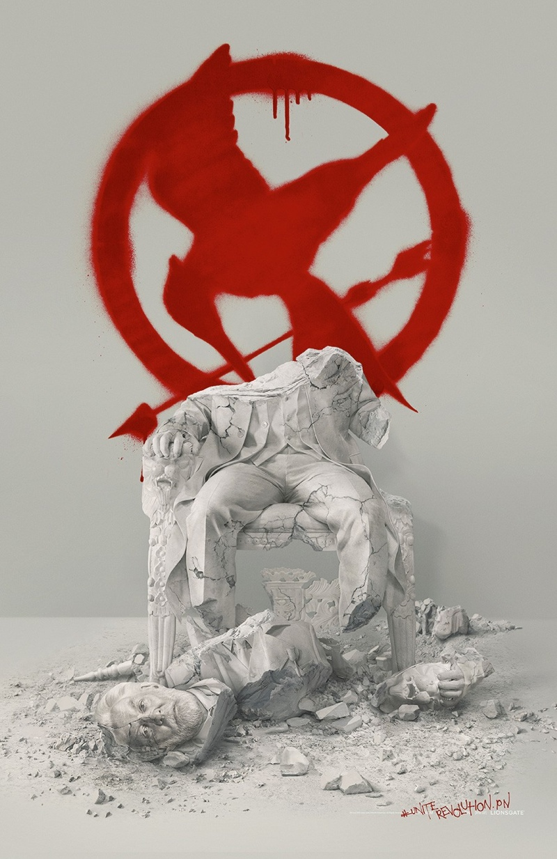 A teaser poster for 'The Hunger Games - Mockingjay Part 2' featuring a vandalized statue of President Snow. Photo: Lionsgate