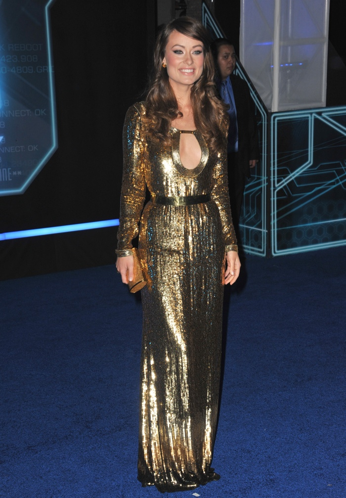 Looking like she was dipped in gold, Olivia Wilde slipped into this metallic Gucci dress at the premiere of 'Tron' in 2010. Photo: Jaguar PS / shutterstock.com