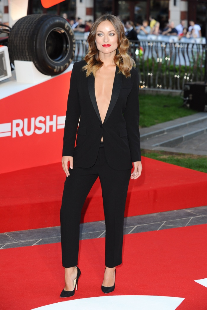 Olivia Wilde suited up in a black Gucci pant suit sans a top at the 'Rush' premiere. Photo: featureflash / Shutterstock.com