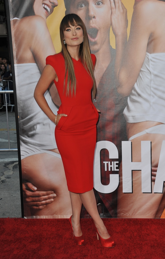 Wearing a shorter hemline, Olivia looked sharp in this red Antonio Berardi dress with pockets. Photo: Jaguar PS / Shutterstock.com