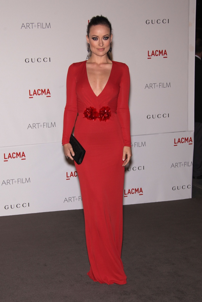 Olivia Wilde looked lovely in a red Gucci gown featuring a sparkling waist embellishment in 2011. DFree / Shutterstock.com