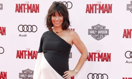 Pregnant Evangeline Lilly poses on the red carpet at the Ant-Man Hollywood premiere. Photo: Tinseltown / Shutterstock.com