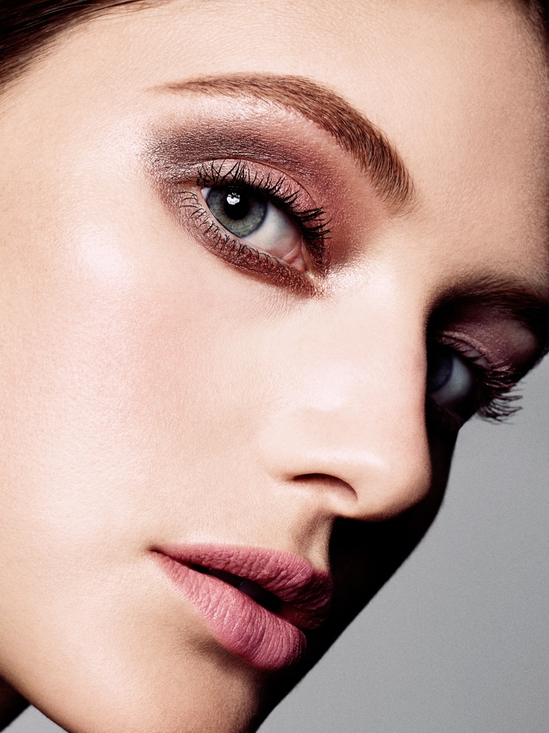 The model wears shimmering eye makeup in the feature