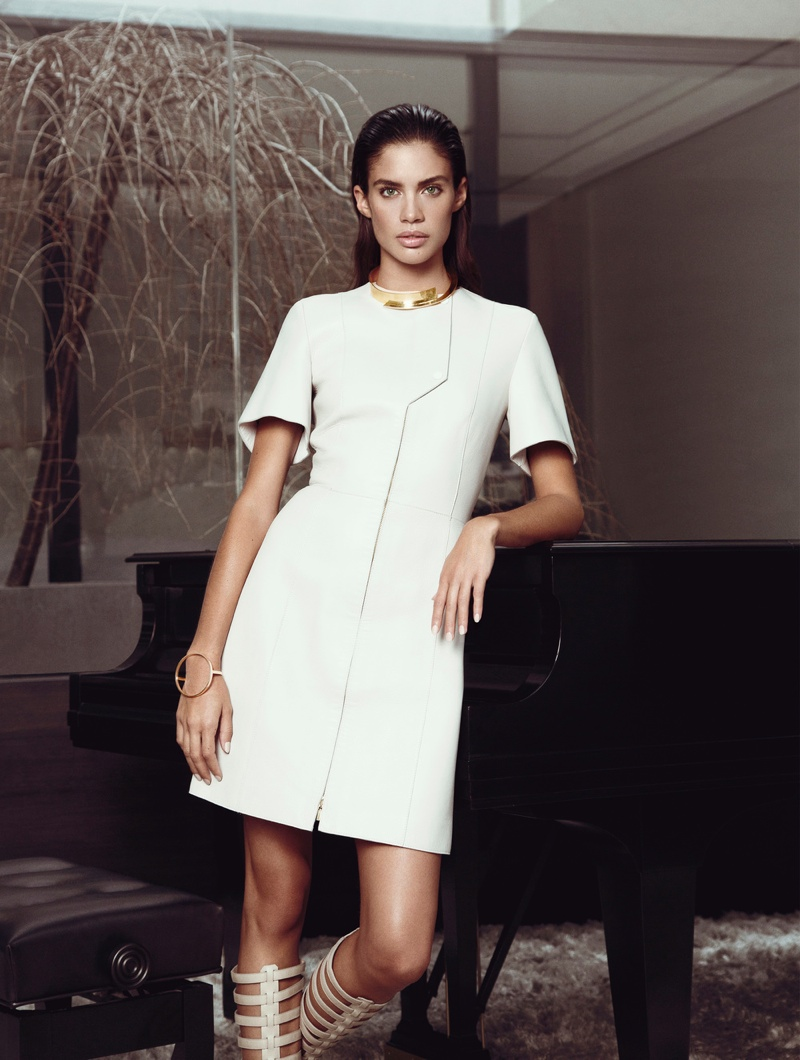 Sara models a white leather dress