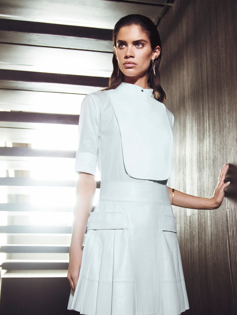 The brunette dons a Ports 1961 dress in white