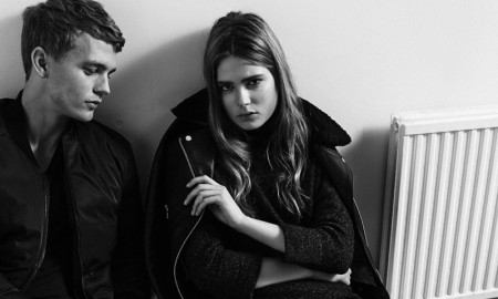 The models make a handsome couple in dark looks