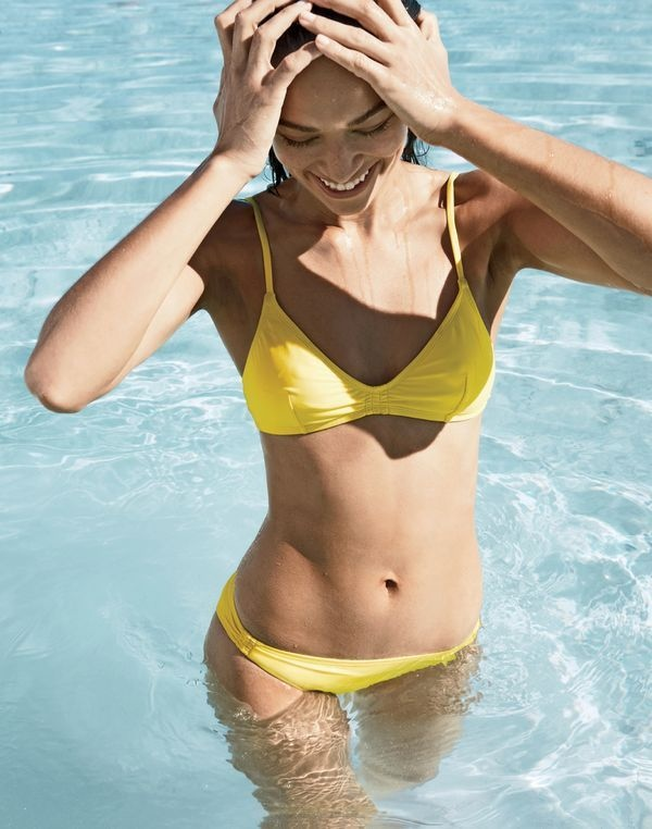 The dark-haired beauty wears a yellow swimsuit look