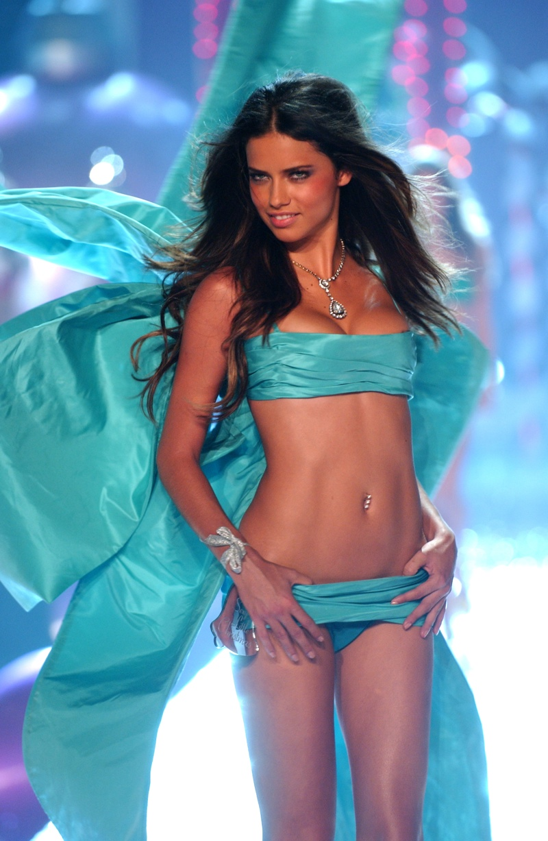 By 2005, Adriana Lima was an Angel for five years. Here she is wearing a turquoise blue number with dramatic wings. Photo: Fashionstock.com / Shutterstock.com