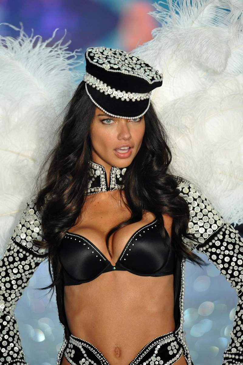 d749601dea ... Adriana Lima looked sexy in a rhinestone embellished motorcycle hat on  the 2013 Victoria s Secret runway