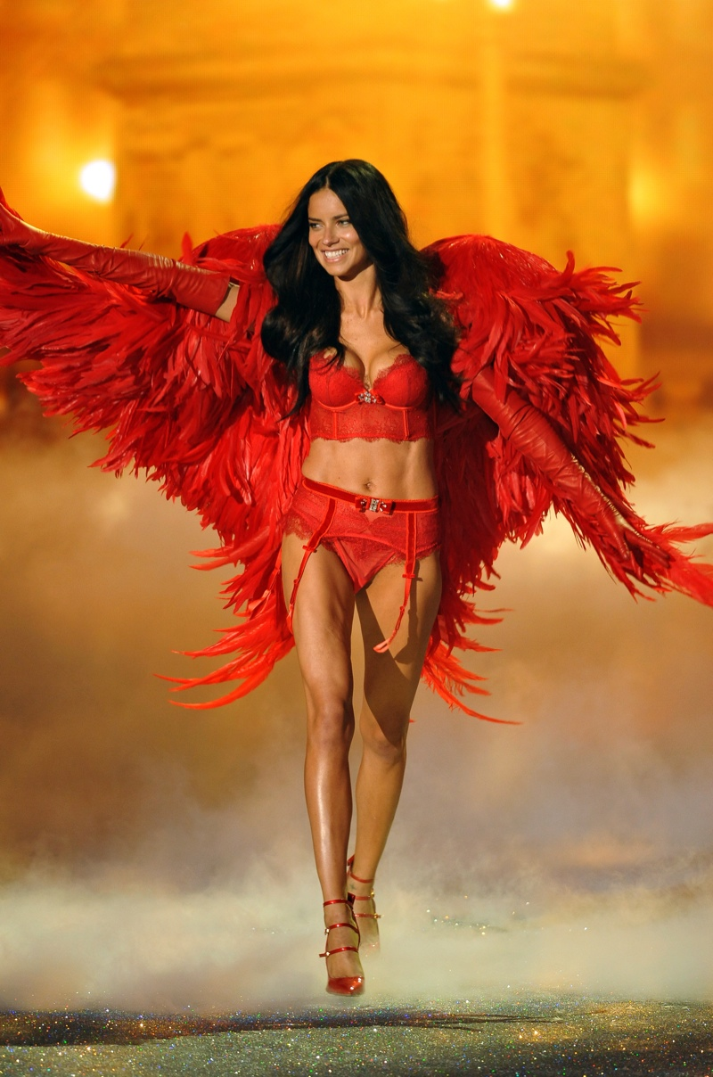 Adriana Lima is known for her signature runway walk where she uses her hands to engage the Victoria's Secret audience members. Here she is at the 2013 Fashion Show wearing a red-hot outfit. Photo: Fashionstock.com / Shutterstock.com
