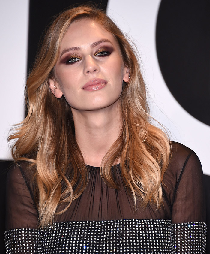 Model and actress Dylan Penn showcases a mix of warm chestnut tones with golden strands for her bronde look. Photo: DFree / Shutterstock.com
