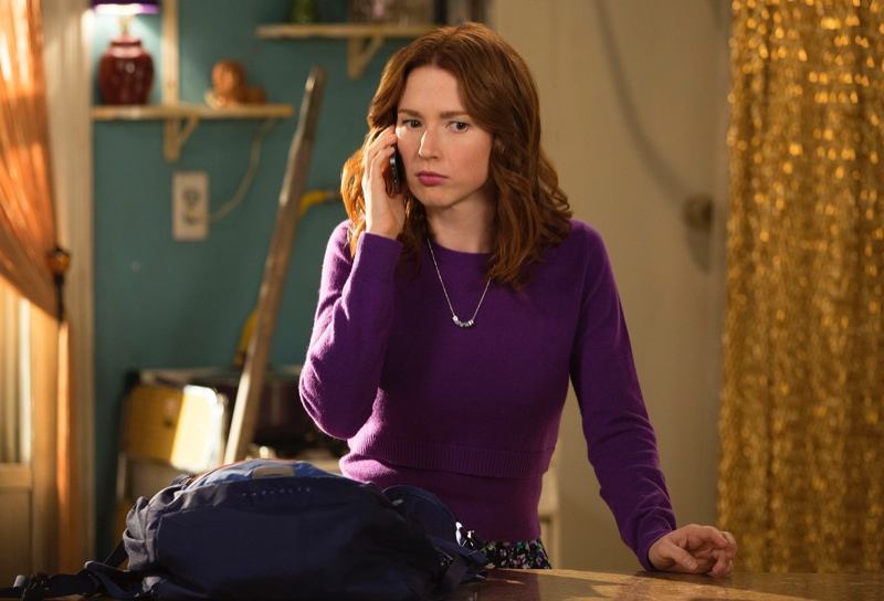 Kimmy Schmidt (Ellie Kemper) shows off a more grownup look with a purple sweater.