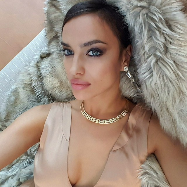 Irina Shayk poses on fur with a sparkling necklace. Photo via Instagram.