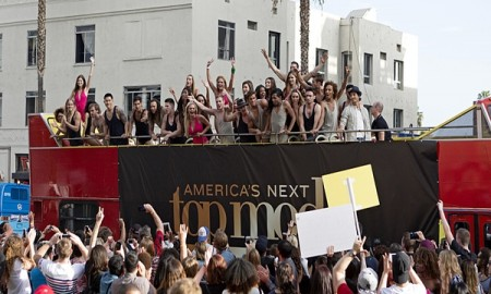 Models on a bus on America's Next Top Model cycle 22 premiere