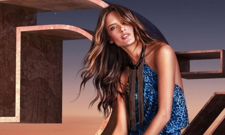 Alessandra models a blue print dress with a halter top neck