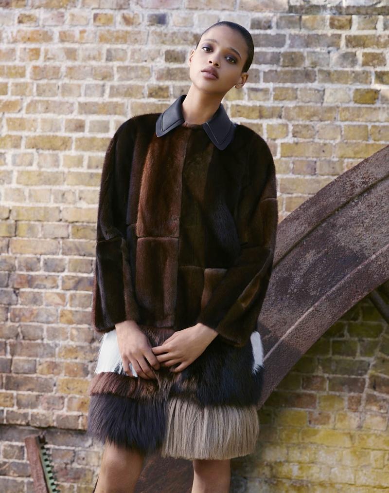 Aya models Fendi patchwork fur coat