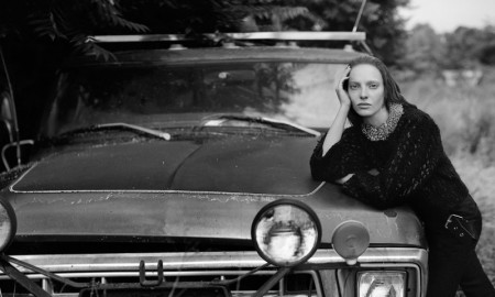 Zlata gets rustic as she poses alongside a vintage car