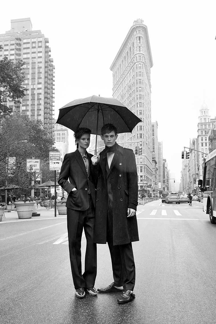 The models pose under an umbrella in this black and white image