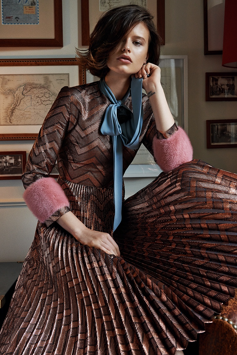 Barbora wears pleated dress with fur detailing from Gucci