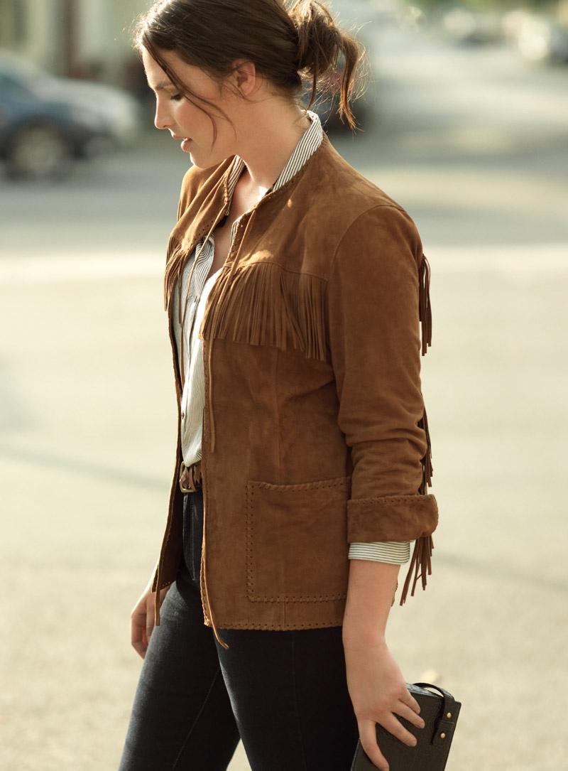Candice models fringe adorned jacket in brown