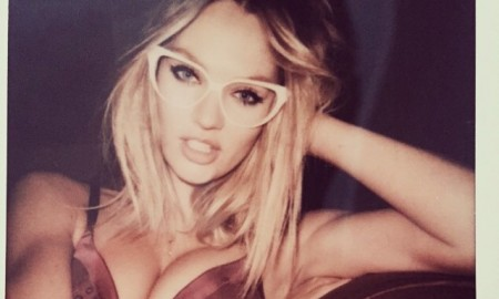 Candice Swanepoel wears cat eye sunglasses in sexy polaroid