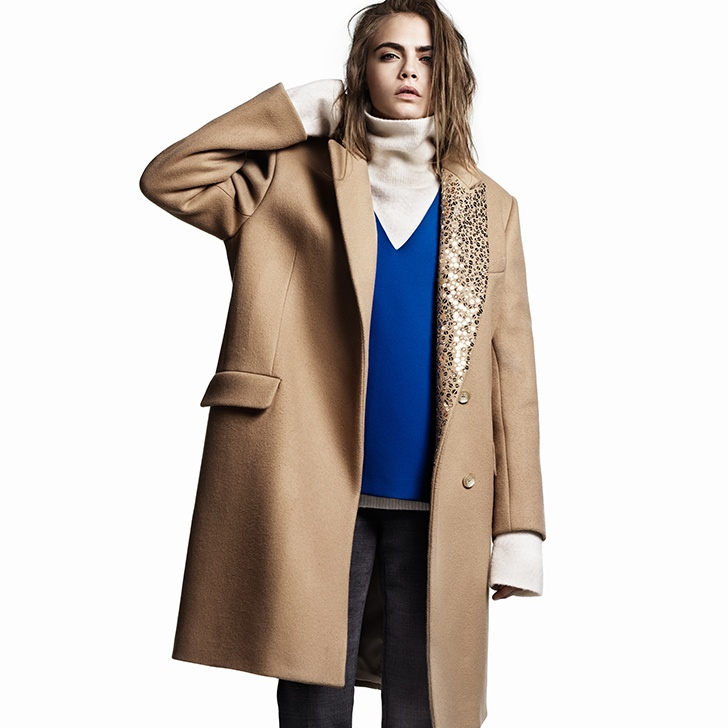 b3849e33849a Cara suits up in a black jacket The model sports an oversized coat with an  embellishment detail