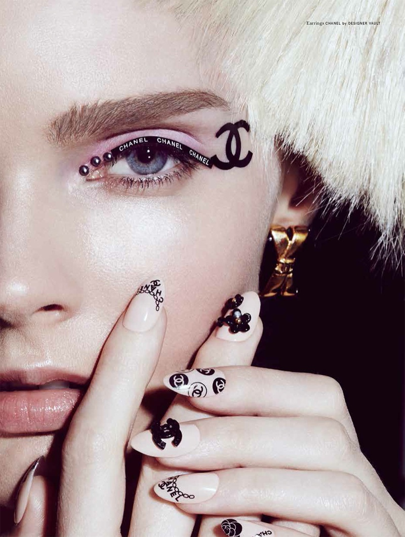 The model wears Chanel beauty looks