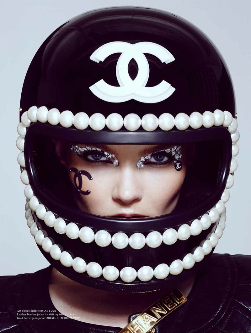 Enly wears a helmet with pearl embellishments
