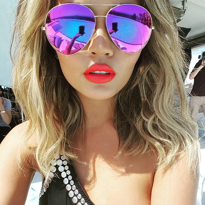 Chrissy Teigen wears Victoria Beckham aviator sunglasses