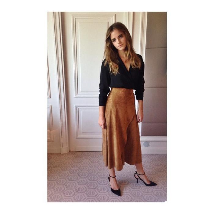 Emma Watson wears Ralph Lauren top and skirt with Paul Andrew heels