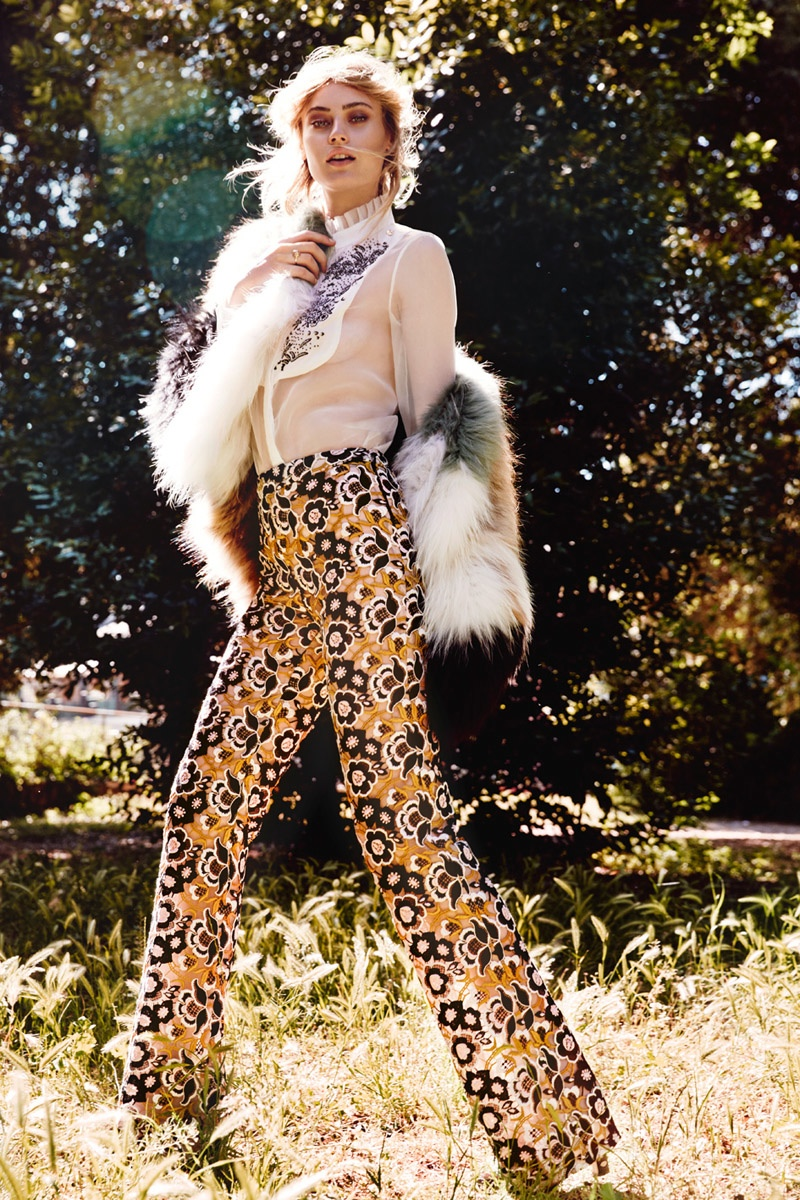 The model wears high-waist pants from Giambattista Valli