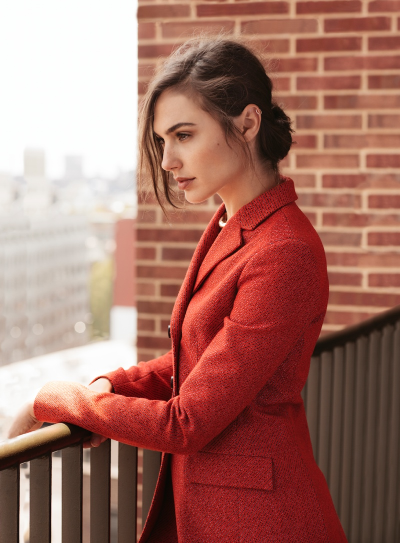 Gal wears red jacket in this image