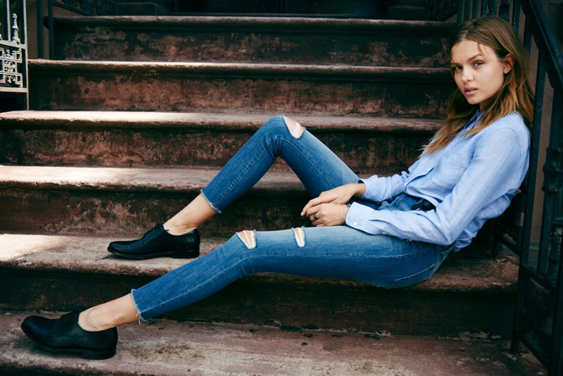 The model wears a distressed denim style from DL1961's fall collection