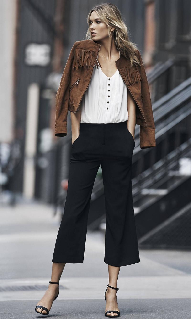 Karlie sports a fringe adorned jacket