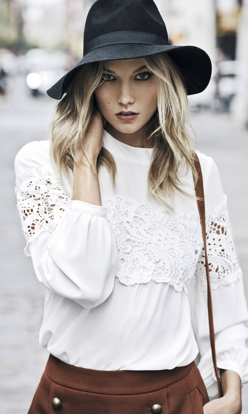 Karlie wears a lace top in white