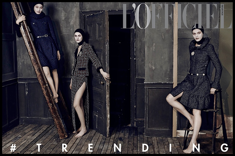 The three models wear looks from the autumn collections in the editorial