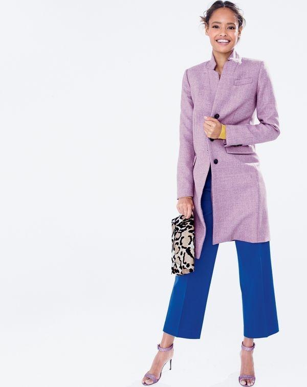 Malaika wears lilac-colored top coat