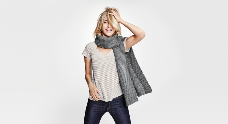 The model wears an oversized scarf with a casual tee and denim