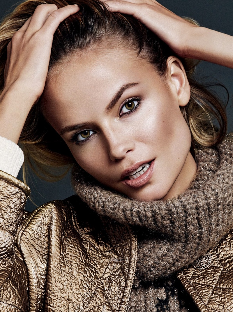 CLOSE KNIT: Natasha wears a turtleneck sweater in this shot