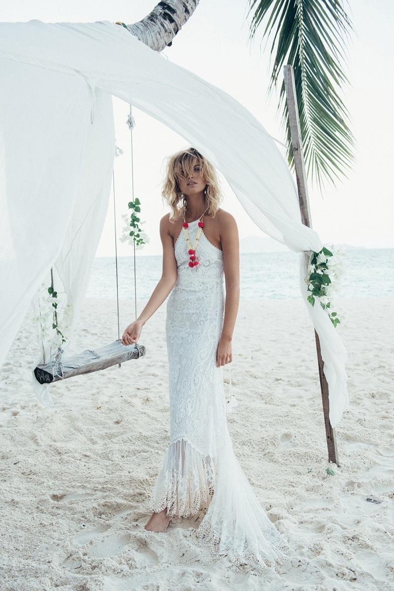 Louise wears Casablanca halter gown