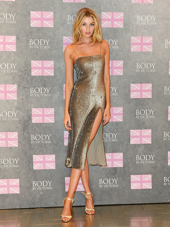 Stella Maxwell wears silver dress at Victoria's Secret Body by ...
