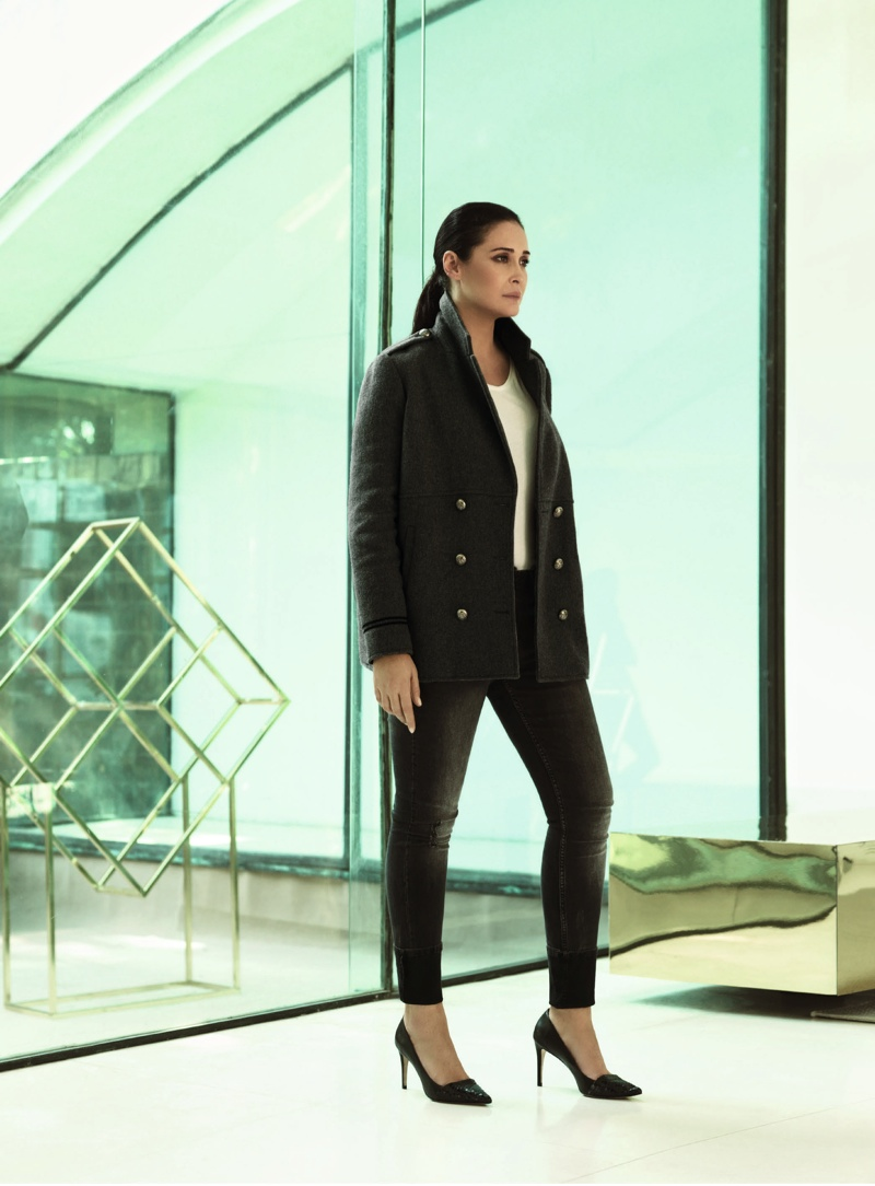 Vicky models a jacket with slim-fit pants
