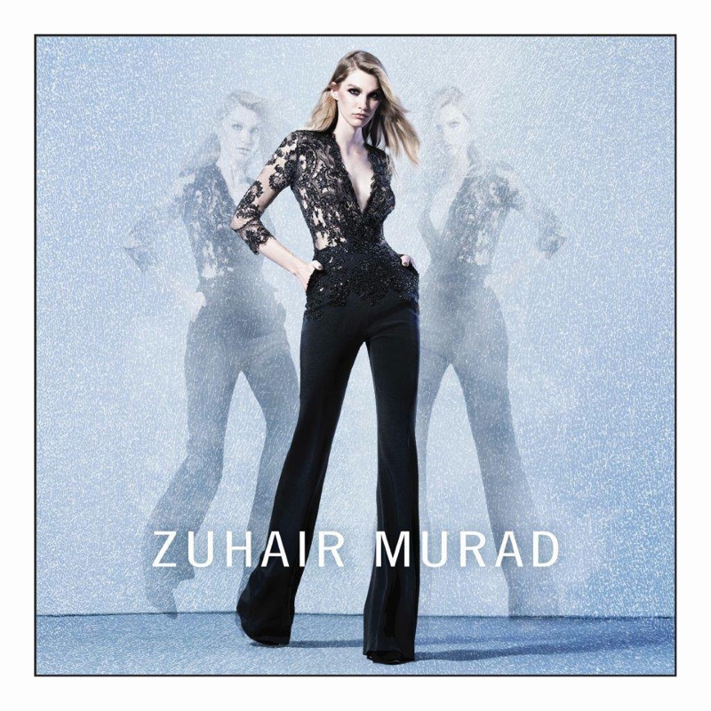 The model wears Zuhair Murad's signature embellishments in a black jumpsuit
